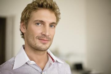 Mid adult man smiling, close-up, portrait