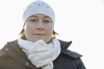 Mid adult woman wearing knit hat, portrait