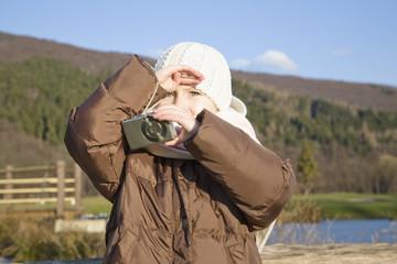 Girl holding digital camera, portrait