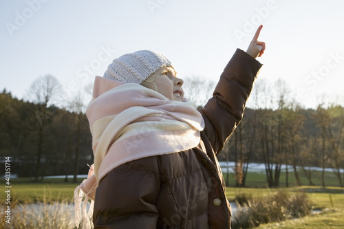 Girl pointing upwards
