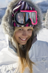 Young woman wearing ski goggles, portrait