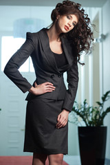 Sexy woman wearing elegant suit