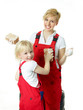 Sisters in overalls have fun to clean the house