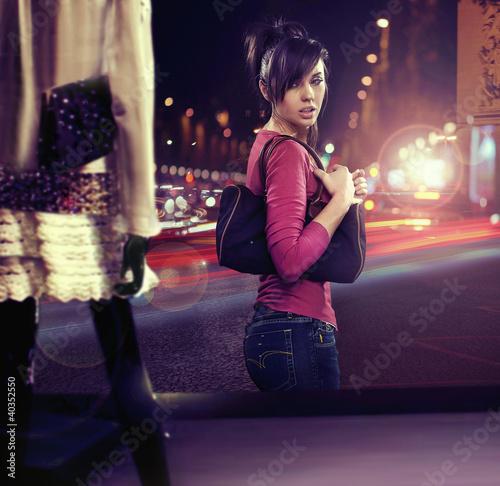 Walking woman looking at shop window