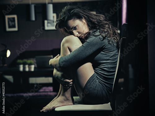 Sad woman sitting on a chair