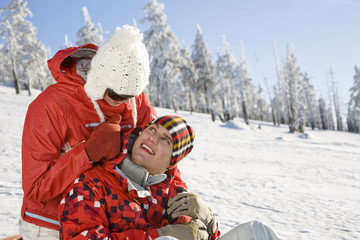 Young couple enjoying on snow