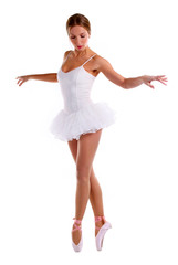 Portrait of ballerina dancing on pointes over white