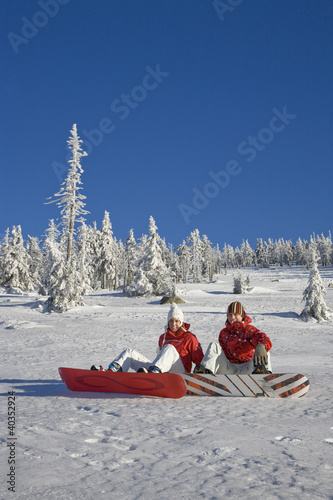 Young couple enjoying on snow, portrait