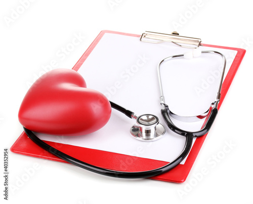 Stethoscope, heart and blank clipboard isolated on white