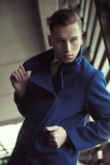 Young man in fashionable coat