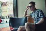 Elegant young man sitting in a bar