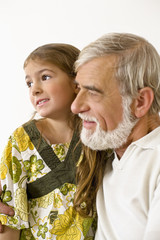 Senior man with granddaughter, side view