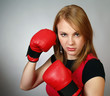 beautiful strong girl in red gloves for boxing