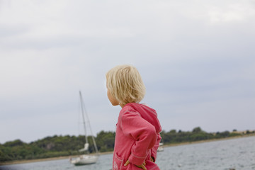 Child standing in harbor