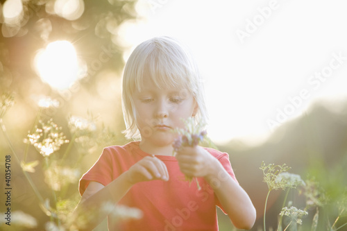 Girl playing in meadow