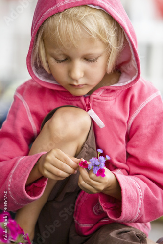 Girl playing with flowers