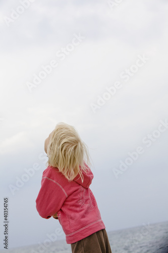 Child looking up at sky