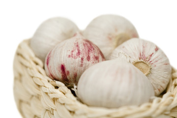 Garlic on basket, close up