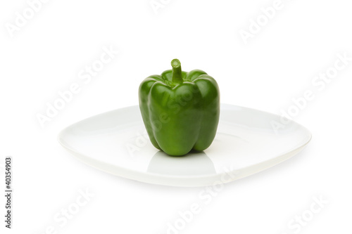 Green bell pepper on plate, close-up