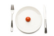 Cherry tomato on ceramic dinner plate, directly above