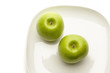 Green apples on plate, directly above
