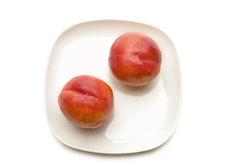 Peach on plate, directly above