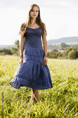 Mid adult woman standing in field, portrait