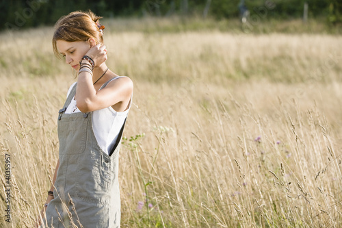 Mid adult woman walking in field