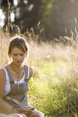 Mid adult woman sitting in field