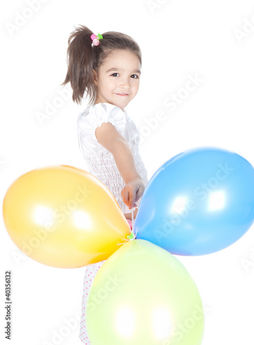 Little brunette girl with balloons in studio