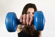Young girl exercising with dumbbells