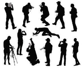 Silhouettes of people taking pictures