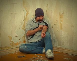bad guy - addict  with a syringe using drugs