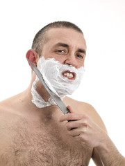 Man shaving with a knife
