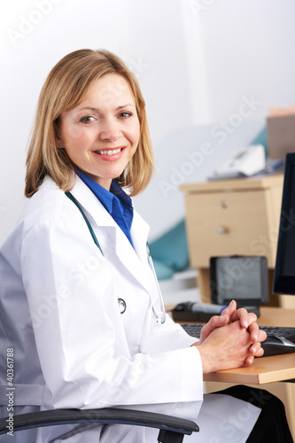 Portrait American doctor sitting at desk