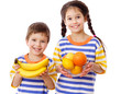 Happy kids holds a tropical fruits