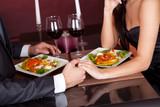 Fototapety Couple at romantic dinner in restaurant