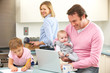 Family busy together in kitchen