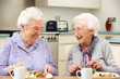 canvas print picture - Senior women enjoying meal together at home