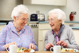 Fototapety Senior women enjoying meal together at home