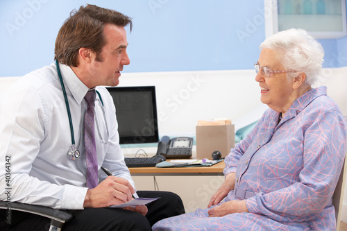 UK GP talking to senior woman patient