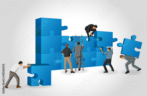 Business men assembling the pieces of a puzzle