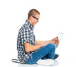 Seated young man using a laptop