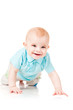smiling baby crawling forward