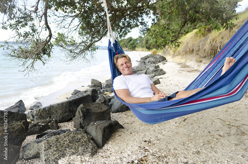 happy smiling man in hammock