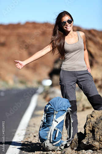 Travel hitchhiker woman happy