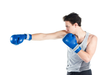 young boxer in gray shirt and blue boxing gloves