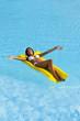 Happy Beautiful woman relaxing on pool
