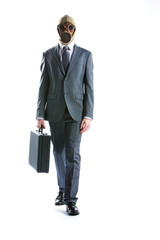 portrait of businessman in a gas mask  with suitcase