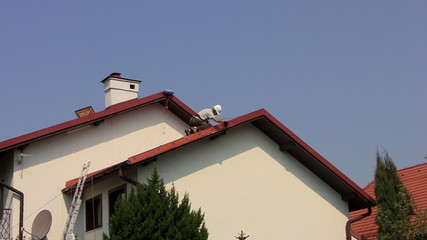 Painting roof of a private house